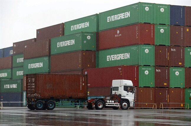 FILE - In this May 21, 2014 file photo, a truck leaves a container terminal in Tokyo. apan logged its 23rd successive month of trade deficits in May, as exports and imports both declined despite signs of recovering demand in the U.S. and Europe. (AP Photo/Shizuo Kambayashi, File)