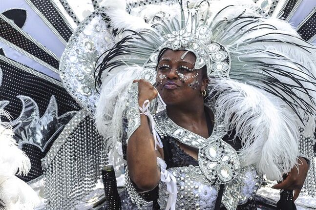 A Scotiabank Caribbean Carnival participant performs for judges in Toronto on Saturday, Aug. 2, 2014. Commonly called Caribana, culminated Saturday with its annual parade, the event culminated Saturday with its annual parade, which typically bustles with colourful costumes, upbeat music and dancing in the streets. THE CANADIAN PRESS/Victor Biro