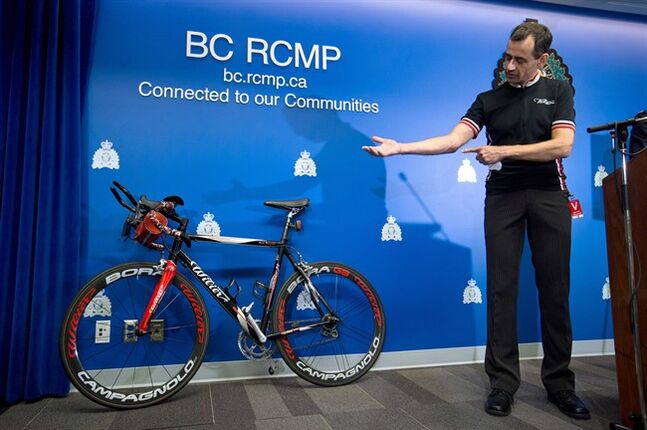 Craig Premack, who was shot while riding on the Trans-Canada Highway at 1 a.m. during an overnight road cycling event near Spences Bridge, B.C., in June, shows where the bullet entered his forearm during a news conference at RCMP headquarters in Surrey, B.C., on Tuesday July 29, 2014. Premack was taking part in the Cache Creek 600, a 600-kilometre, two-day cycling marathon from Pitt Meadows to Cache Creek. THE CANADIAN PRESS/Darryl Dyck