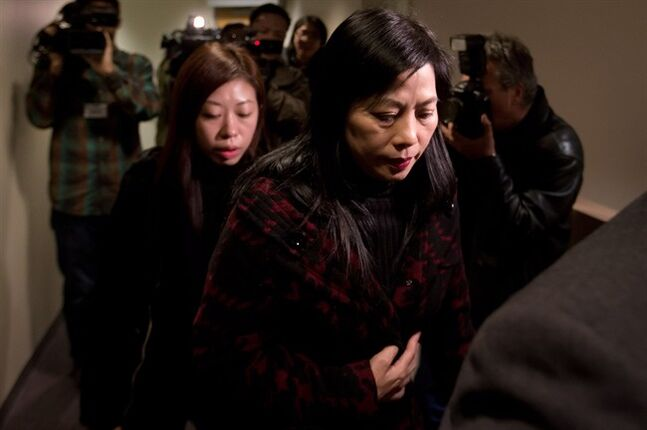 Alleged crime boss Tong Sang Lai's wife Sap Mui Vong, right, and oldest daughter Kei Lai, left, enter an Immigration and Refugee Board admissibility hearing in Vancouver, B.C., on Tuesday February 26, 2013. Tong San Lai who arrived in Vancouver in 1996 did not attend the hearing in person. Federal lawyers are trying to have him removed from the country alleging he he lied about his membership in a criminal organization so he could enter Canada. THE CANADIAN PRESS/Darryl Dyck