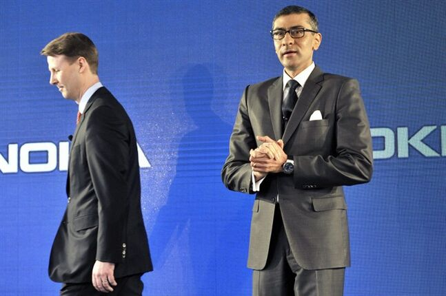 New President and Chief Executive Officer of Nokia Rajeev Suri, right, speaks beside Chairman of the Board of Directors and interim CEO of Nokia Risto Siilasmaa during the press conference where Nokia announced first quarter earnings in Espoo, Finland Tuesday, April 29, 2014. Nokia Corp. says it continued to be hit by fierce competition in the first-quarter with a 30 percent fall in sales of mobile devices, the troubled unit it sold to Microsoft last week. (AP Photo/Lehtikuva, Heikki Saukkomaa) FINLAND OUT, NO SALES