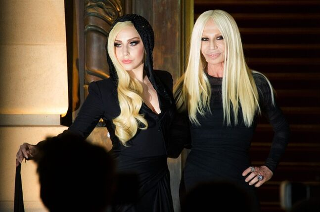 Lady Gaga, left, and fashion designer Donatella Versace arrive to the attend Atelier Versace Spring-Summer 2014 Haute Couture fashion collection, presented Sunday, Jan. 19, 2014 in Paris. (AP Photo/Zacharie Scheurer)