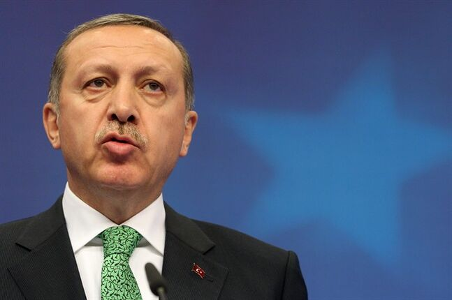 Turkey's Prime Minister Recep Tayyip Erdogan addresses the media, after a meeting at the European Council building in Brussels, Tuesday, Jan. 21, 2014. Erdogan is on a two-day visit to meet with various EU officials. (AP Photo/Yves Logghe)