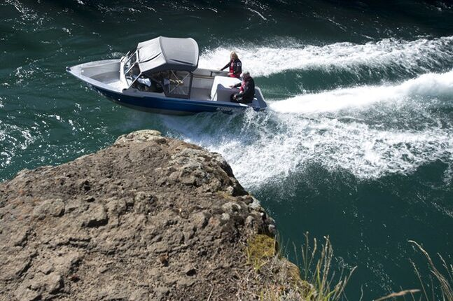 Canadian Prime Minister Stephen Harper and wife Laureen take a ride in a boat through Miles Canyon up the Yukon River in Whitehorse Friday August 22, 2014. THE CANADIAN PRESS/Adrian Wyld