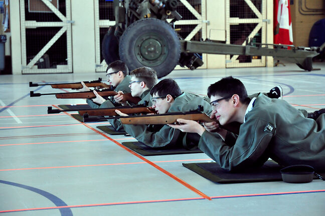 Master Bombadier Shane Houle, Warrant Officer Colin Lowrie, Gunner Connor Browett and Bombardier Ben Bolech fire in the prone position at Stage II Marksmanship Competition, Brandon Armoury.