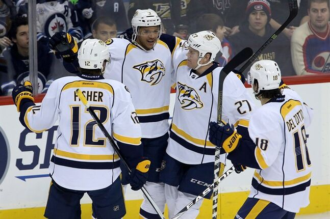Nashville Predators celebrate a period goal in Winnipeg, Tuesday, January 28, 2014. THE CANADIAN PRESS/Trevor Hagan