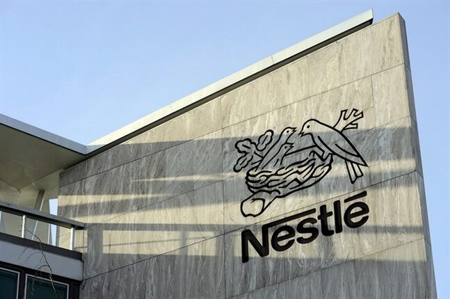 In this Feb. 14, 2013 photo, the Nestle logo is pictured on the Nestle headquarter in Vevey, Switzerland. THE CANADIAN PRESS/AP, Keystone, Laurent Gillieron