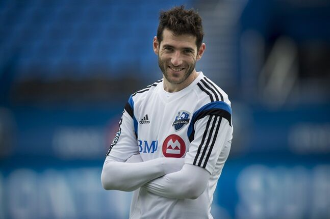Montreal Impact's newly acquired player Ignacio Piatti smiles for the cameras during a practice on Thursday, August 14, 2014 in Montreal. THE CANADIAN PRESS/Paul Chiasson