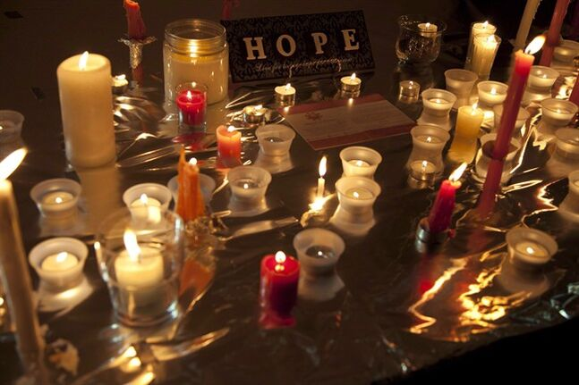 Candles are seen during a memorial for Amanda Todd in Surrey, B.C., Oct. 19, 2012. THE CANADIAN PRESS/Jonathan Hayward