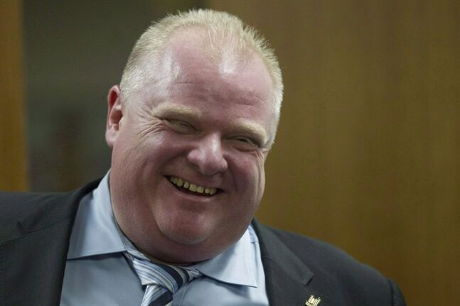 Toronto Mayor Rob Ford (right) shares a laugh with one of his staff members outside his office at city hall in Toronto on Wednesday, March 19, 2014. A media report is making fresh claims about Rob Ford, with accusations the Toronto mayor was driving while under the influence and making racist and sexual comments. THE CANADIAN PRESS/Chris Young