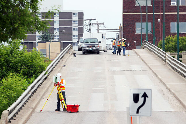 Workers with Dillon Construction conduct a detailed inspection of the Eighth Street bridge in 2011. A final report is expected mid-March.