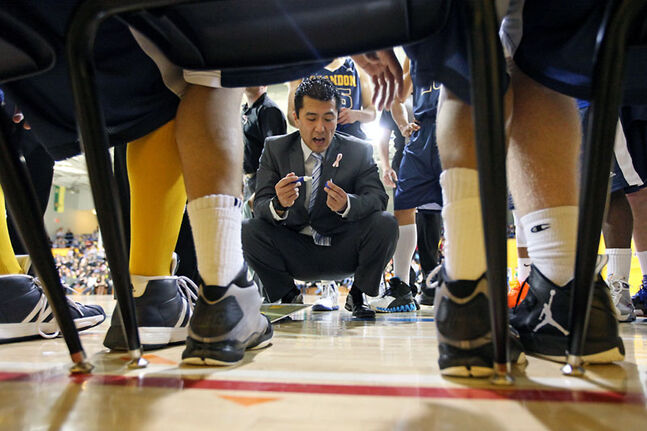 Brandon University Bobcats head coach Gil Cheung addresses his players during a timeout in a Canada West game this season at the BU gymnasium.