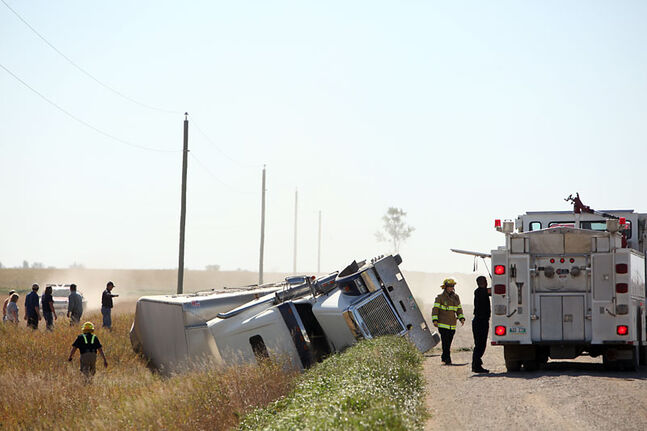 Emergency crews respond to a semi-trailer that overturned on Provincial Road 103 west, about 14 km south of Brandon in the RM of Cornwallis on Friday afternoon. Sixty-four head of cattle were trapped in the vehicle. Many were rescued but some had to be put down on the spot due to injuries. RCMP said the driver of the rig was taken to hospital with undetermined injuries.