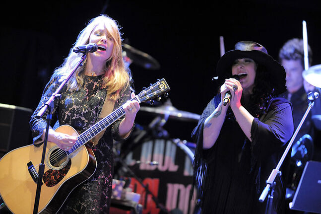 Nancy Wilson (left) and Ann Wilson of Heart perform at the MusiCares MAP Fund benefit concert in Los Angeles in May. The veteran rock group announced Monday that their 2013 tour will include a concert at Brandon's Westman Place on March 15.