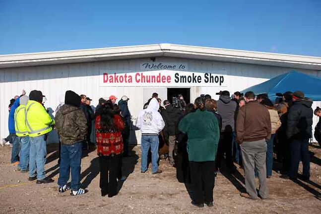 A crowd gathers for the grand opening of the Dakota Chundee Smoke Shop on Highway 2 east of Pipestone in 2011.