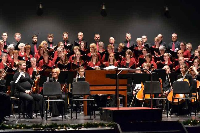 "Oak Lake choirs the Noteable Women and The Heard sing ""The   Messiah"" by Handel with the Winnipeg Symphony Orchestra in Winnipeg last December. On Sunday, the two Oak Lake choirs will perform at St. Paul's United Church in Souris."