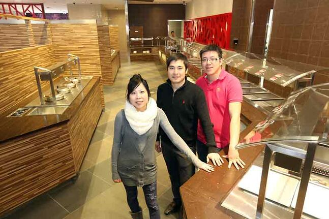 Huy Weng, left, Ivan Ye and Ivan Tang are helping open the city's newest restaurant, Ye's Buffet, located at 201 18th St. North.