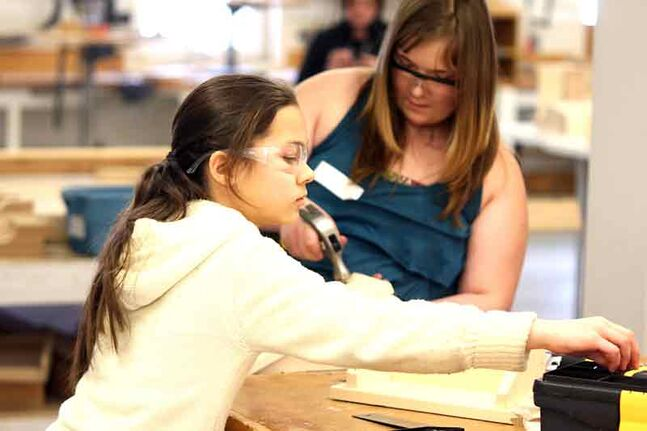 Darina Fakhrutdinova, 11, of Douglas Elementary School and Autumn Ward, 11, of Tanner's Crossing School in Minnedosa work on building a shelf, as part of the Career Trek program at the Westbran Training Centre on Saturday. The program helps kids in grades 5 and 6 discover a long list of careers, including carpentry.