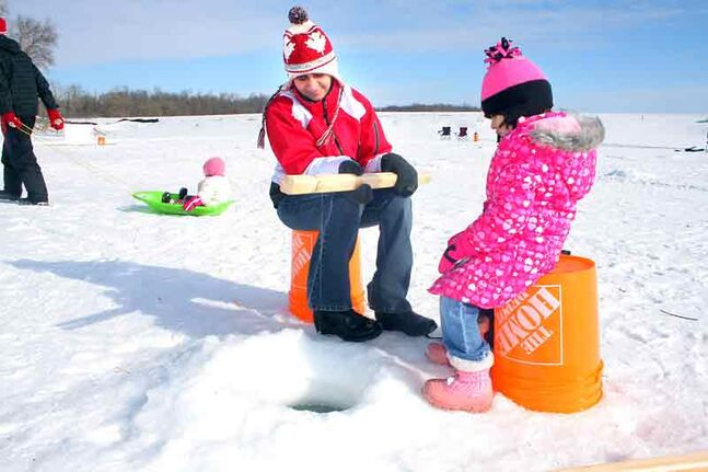 Maryam Palanpurwala and her three-year-old daughter Hussena Rangwala wait patiently for a nibble while ice fishing on Marshs Lake at Spruce Woods Provincial Park on Saturday.