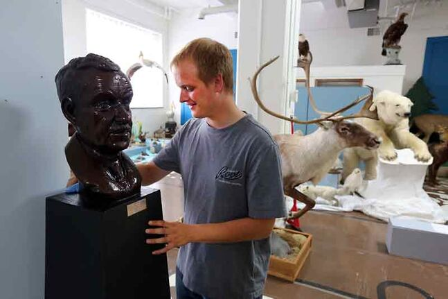 Curator Mark Veneziano polishes a bust of the founder of the B.J. Hales collection for an exhibition for its debut this weekend at the Brandon General Museum and Archives. The collection of local fauna has specimens from the 1890s to the 1920s and represents wildlife found in this part of Manitoba.