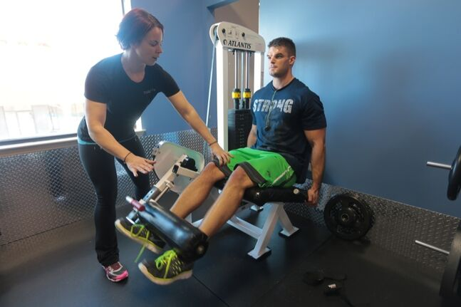 Fitness Quest trainer Lylas Leona Poulton works with Bryce Pettinger as he works on his leg exercises at the Town Centre fitness gym on Monday afternoon.