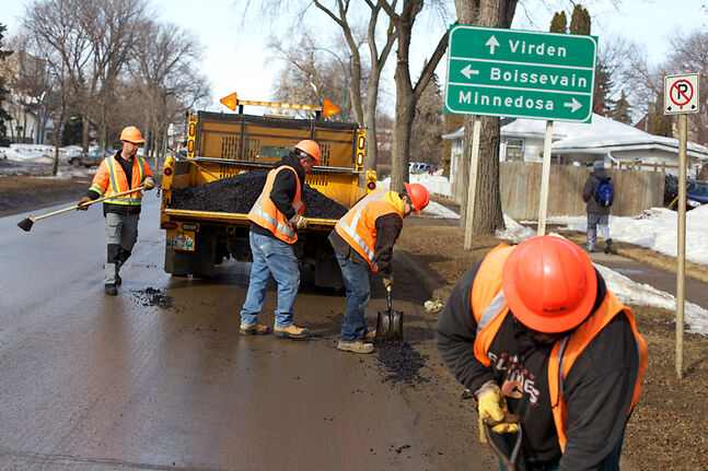 Manitoba Infrastructure and Transportation workers patch potholes along Victoria Avenue — voted the province's worst road last year in a CAA Manitoba campaign — in April 2013.