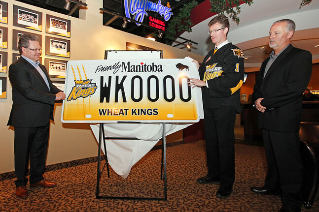 Brandon Wheat Kings owner, general manager and head coach Kelly McCrimmon, left, Manitoba Justice Minister Andrew Swan — who is also the minister responsible for Manitoba Public Insurance — and Brandon Humane Society board president Darren Creighton unveil the Brandon Wheat Kings licence plate at the Canad Inns on Tuesday. The new plates will be available on Monday, Feb. 24, and $30 from the purchase of each set of plates will benefit the Brandon Humane Society.