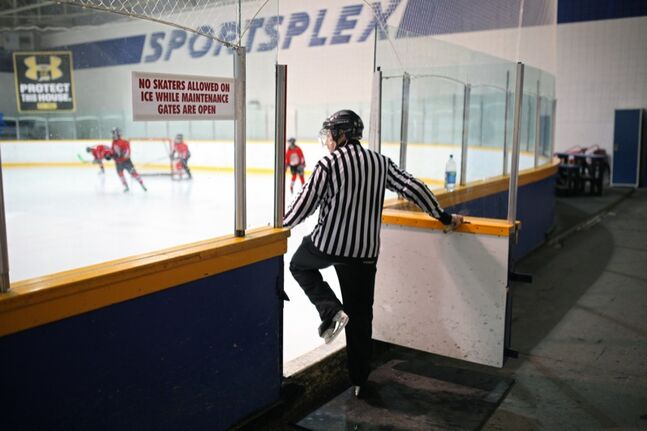 Referee Gary Ward steps onto the ice at the Sportsplex to officiate a girls hockey game on Thursday evening.