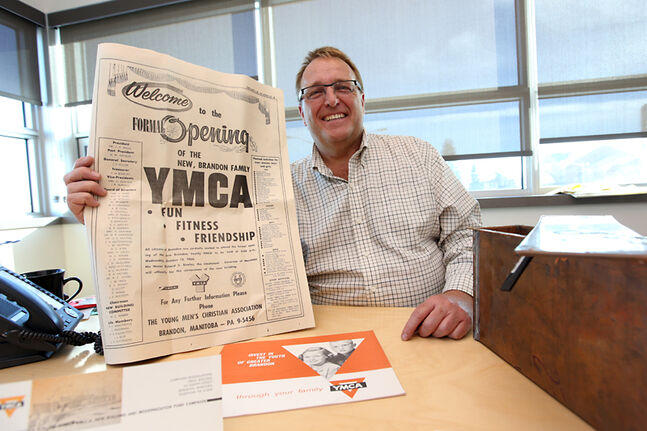 Lon Cullen, CEO of the YMCA of Brandon, displays items from a time capsule entombed in a wall at the site of the former Brandon YMCA facility in 1966, while at his office in the new Dood Cristall Family YMCA recently. Among the items in the capsule were coins, YMCA literature and a copy of the Brandon Sun.