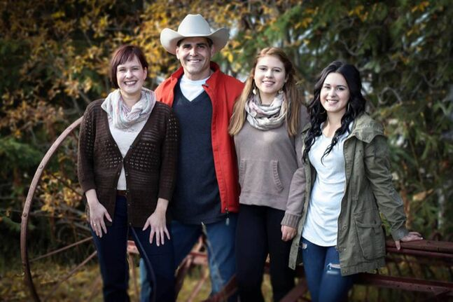 Les Jackson of Prince George, BC. poses with his wife Lisa (left) and his daughters  Grace and Abby (far right) in this family photo. Jackson, who was born in Virden, is on a search for his biological parents and hopes a new Manitoba legislation which will further open up adoption records will help him on his journey.