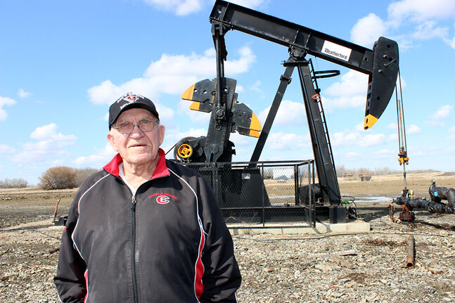 Jake Sanheim stands near one of 17 new oil wells on his farm in the Manson Field. Sanheim estimates the oil royalties are worth $5 million a year on his land alone, but the 81-year-old doesn't get them —  the province owns the mineral rights. While Sanheim receives surface rights payments that are worth substantially less money, the unexpected income is nice.