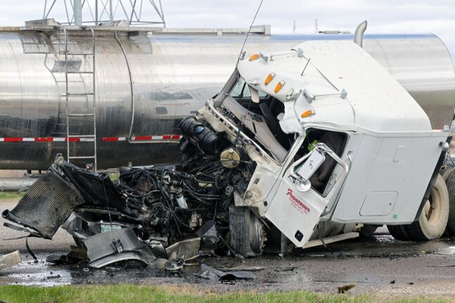The cab of a fuel tanker truck sits destroyed after a collision between two tankers at the intersection of Richmond Avenue East and Highway 110 east of Brandon on Monday afternoon. The driver of the truck was taken to hospital with non-life-threatening injuries. Meanwhile thousands of litres of fuel spilled from the other truck.