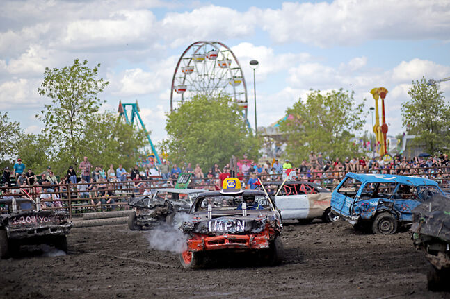 Competitors crash and bash each other in hopes of taking home the trophy in the feature heat during the Manitoba Summer Fair Demolition Derby on the southwest grounds of the Keystone Centre on a hot Sunday afternoon.