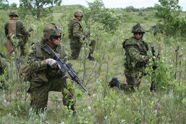 Pte Gary Boucher (left) surveys the area with fellow 2PPCLI soldiers at CFB Shilo on Thursday as the group prepares for their upcoming training in Hawaii.