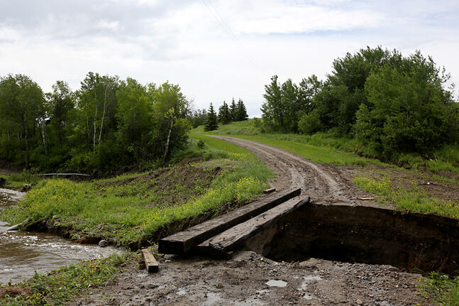 Damage is visible after a swollen creek at the northwest end of Sioux Valley Dakota Nation washed out the driveway to a home, cutting it off from nearby Highway 21 during flooding last weekend.