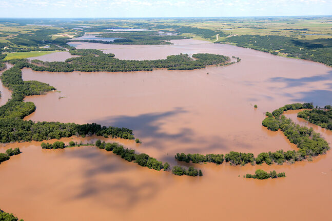 An aerial photo shows floodwaters in the Assiniboine River Valley northeast of Virden on Thursday.