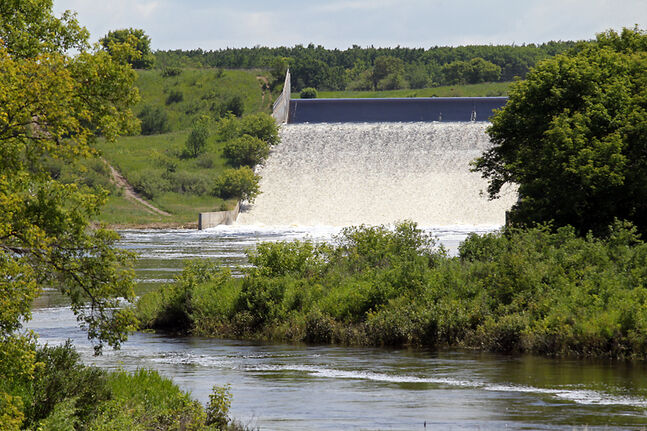 Water pours down the spillway from the Rivers Reservoir into the Little Saskatchewan River just southeast of Rivers on Monday. A Rivers woman and a Brandon man are dead after an ATV accident at the spillway on Saturday.