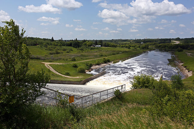 Water pours down the spillway from the Rivers Reservoir into the Little Saskatchewan River just southeast of Rivers. A Brandon man and a Rivers woman are both dead after an ATV accident at the spillway on Saturday.
