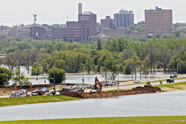 Construction crews rush to finish the Grand Valley Road dike in early July as the Assiniboine River floods unexpectedly. The road finally reopened yesterday, but Brandon will need to spend the next few weeks ahead of the election debating future flood strategies.