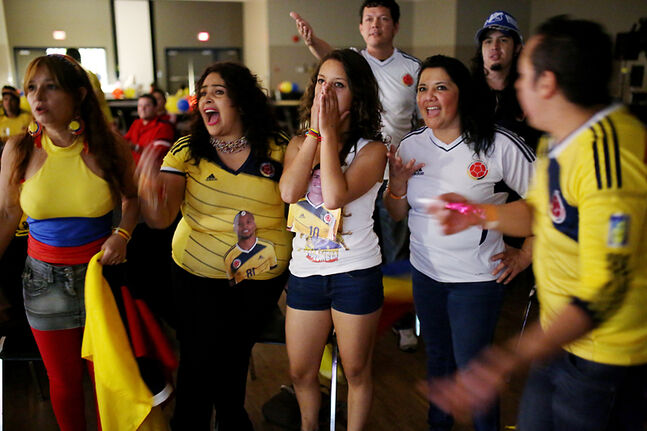 Diehard Colombia fans react to a play during the second half of the country's FIFA World Cup quarter-final against Brazil while watching the match projected on screens at the Keystone Centre on Friday afternoon. About 100 local Colombians turned out to watch the match, and went home proud despite their team's 2-1 loss.