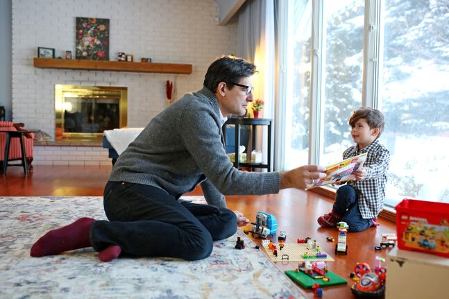 Paul Alexandre plays Lego with his four-year-old son Julien at their Brandon home on Thursday. Alexandre, who moved to Canada from France 16 years ago, wants to send his son to Brandon's only single-track French immersion school — École Harrison — and as a francophone, doesn't believe that should be decided by the Brandon School Division's lottery-style system.