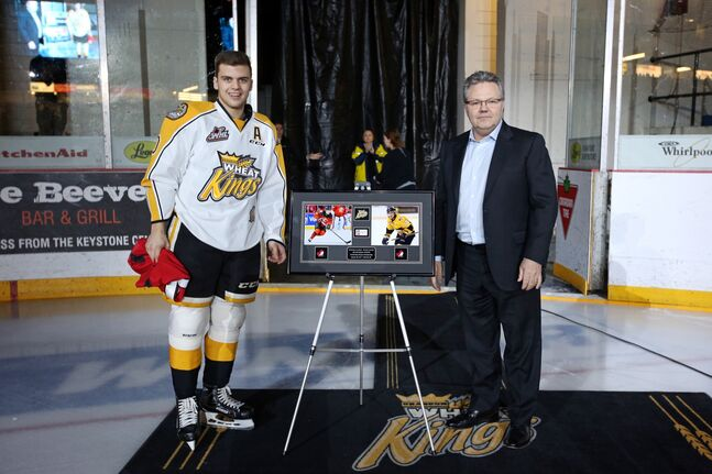 Kale Clague of the Brandon Wheat Kings was congratulated by team owner Kelly McCrimmon on his world junior hockey championship silver medal with team Canada prior to the Brandon's home game against Calgary on Saturday evening.