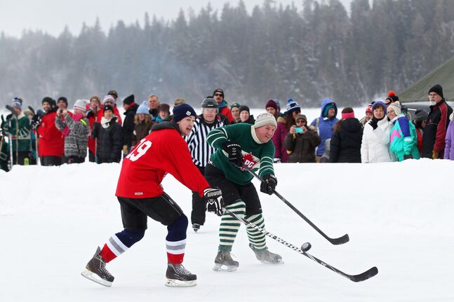 Spectators watch the action as area residents take on Parks Canada staff in the Canada 150 Heritage Hockey Game on the ice at Clear Lake in Riding Mountain National Park during the park's Winter Adventure Weekend on Saturday afternoon.