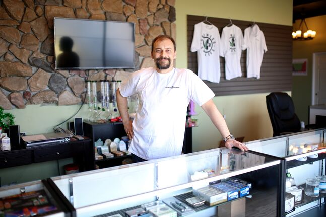 Rick Macl, owner of Growers n' Smokers on 18th Street North, stands behind the counter in his marijuana supply shop on Saturday after opening the store on Friday.