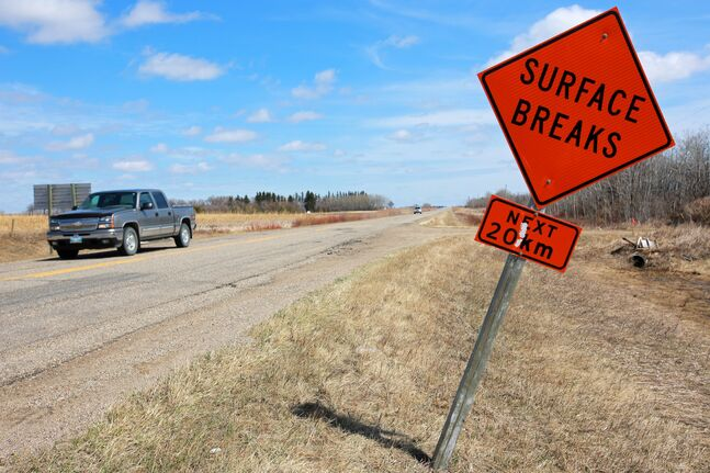 A pickup truck travels along Provincial Road 353, a.k.a. Brookdale road, north of Brandon, past a sign warning of the poor road conditions, on Tuesday afternoon. The Canadian Automobile Association released its annual Top 10 Manitoba worst roads list on Tuesday and Brookdale road ranked second worst for the province.