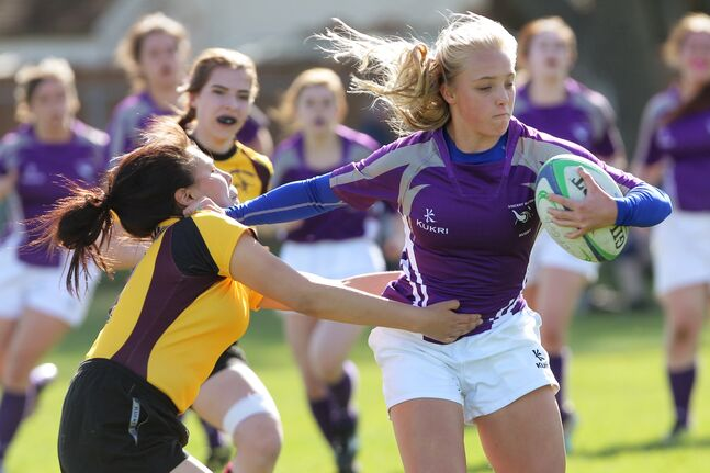 Charlot Butler of the Vincent Massey Vikings fends off Kayleigh Mousseau of the Crocus Plainsmen during Westman High School Rugby girls' action at Massey on Thursday.