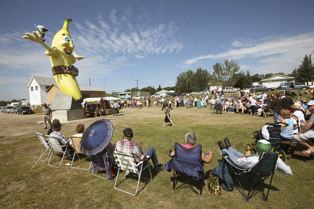 Brandon Sun 07082010 Residents and out-of-towners alike take in the unveiling ceremony for the Melita Banana on a scorching hot Saturday afternoon. (Tim Smith/Brandon Sun)