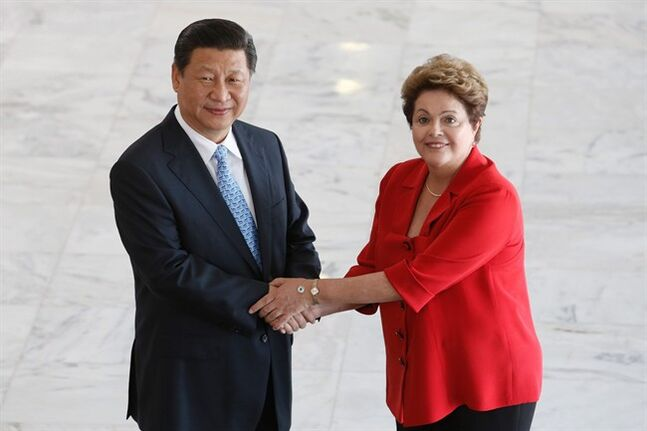 China's President Xi Jinping, left, and Brazil's President Dilma Rousseff pose for a photo after his arrival to the Planalto Presidential Palace, in Brasilia, Brazil, Thursday, July 17, 2014. (AP Photo/Eraldo Peres)