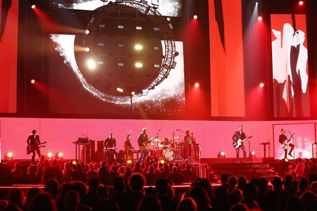 Lindsey Buckingham, center, performs on stage with members of Queens of the Stone Age and Nine Inch Nails at the 56th annual Grammy Awards at Staples Center on Sunday, Jan. 26, 2014, in Los Angeles. (Photo by Matt Sayles/Invision/AP)