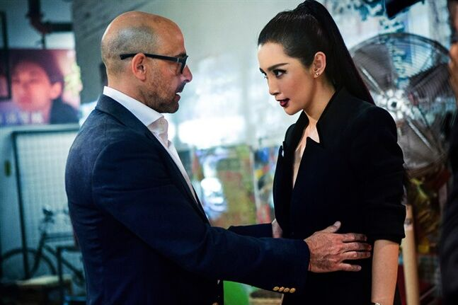 This photo released by Paramount Pictures shows Stanley Tucci, left, as Joshua Joyce and Li Bingbing as Su Yueming, in